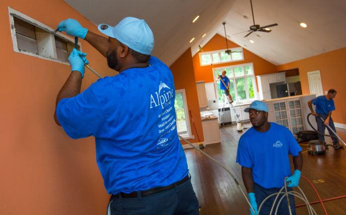 Cleaning team doing air vents cleaning in a home